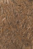 Wooden chipboard texture. Close-up view of brown wooden chipboard texture Stock Images