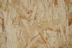 Wooden Chips. Compressed wood panel background made from chips and shavings Stock Photography