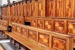 Wooden choir stalls. Medieval wooden choir stalls Stock Image