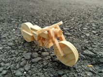 Wooden chopper bike. Chopper motorcycle toys made from pine wood Royalty Free Stock Photo