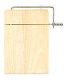 Wooden chopping board with cheese cutter Royalty Free Stock Images