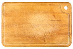Wooden chopping board isolated on white. Old, wooden chopping board isolated on white background Royalty Free Stock Images