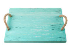 Wooden chopping board painted with turquoise paint Royalty Free Stock Images