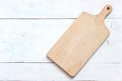Wooden chopping board on white Royalty Free Stock Photos