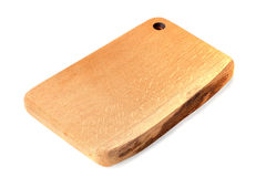 Wooden chopping board on white Royalty Free Stock Images