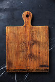 Wooden chopping cutting board Royalty Free Stock Images