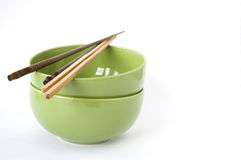 Wooden chopstick on green bowl Royalty Free Stock Photo