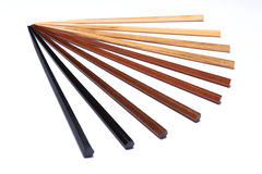 Wooden chopsticks. Chopsticks made from different types of wood, isolated on white royalty free stock images