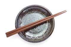 Wooden chopsticks and black ceramic plate Stock Photo