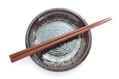 Wooden chopsticks and black ceramic plate Stock Photo