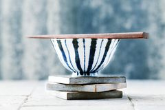 Wooden Chopsticks and ceramic Bowls. Japanese, traditional, handcrafted ceramic. Horizontal Stock Photography