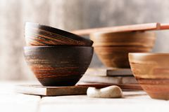 Wooden Chopsticks and ceramic Bowls. Traditional, handcrafted ceramic. Horizontal. Close up Stock Image