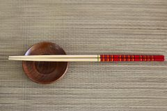 Wooden chopsticks, small brown bowl on background stock images