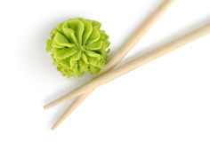 Wooden chopsticks and wasabi isolated Royalty Free Stock Photo