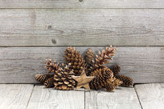 Wooden Chrismas star with cones Royalty Free Stock Image