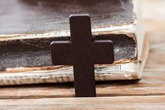 Wooden Christian cross on bible. Royalty Free Stock Photos