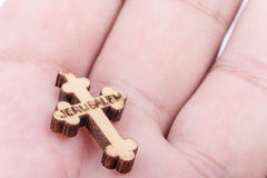 Wooden christian cross blessed in Jerusalem in hand royalty free stock image