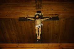 Wooden Christian cross crucifix with Jesus Christ on the cross. In southern Poland stock photo