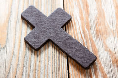 Wooden Christian cross on wooden table. Royalty Free Stock Photos
