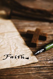 Wooden christian cross and word faith Royalty Free Stock Photography