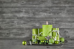 Wooden christmas or advent background with green decoration, can Stock Images