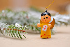 Wooden Christmas angel with gift.  Stock Images