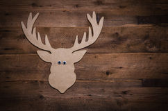Wooden christmas background with antlers or reindeer decoration. Stock Photo