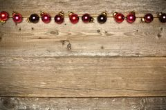 Wooden Christmas background with baubles Stock Photos
