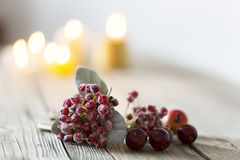 Wooden Christmas background and candle light, with burning candle Royalty Free Stock Photo