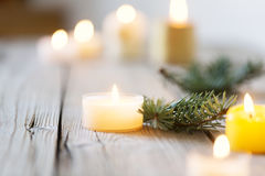 Wooden Christmas background and candle light, with burning candle Royalty Free Stock Photography