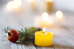 Wooden Christmas background and candle light, with burning candle Stock Photo