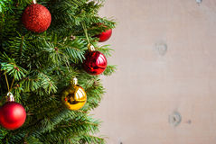 Wooden christmas background with decorated tree. Horisontal Royalty Free Stock Photos