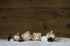 Wooden christmas background with decoration like presents, balls stock photos