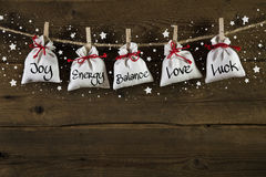 Wooden christmas background: greeting card with presents and tex. T: joy, energy, balance, love, luck Stock Photography