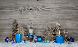Wooden christmas background in grey with blue turquoise nutcrack Stock Photo