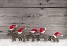 Wooden christmas background with a group of santa clause on wood Stock Photo