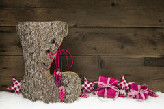 Wooden christmas background with a handmade boot of wood. Stock Photos