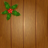 Wooden Christmas background with holly berry Stock Images