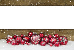 Wooden christmas background with red balls for a greeting card. Royalty Free Stock Images