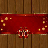 Wooden Christmas background with red bow. Wooden background with red bow, stars and snowflakes, illustration Royalty Free Stock Photos
