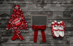 Wooden christmas background with red decoration and an empty adv Royalty Free Stock Photo