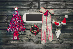 Wooden christmas background with red decoration and an empty sig Royalty Free Stock Photo