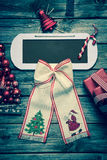 Wooden christmas background with red decoration and an empty sig Stock Photography