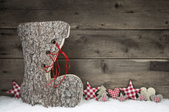 Wooden christmas background in red and grey with santa boot. Stock Images