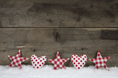 Wooden christmas background with red white checked hearts and st Stock Photo
