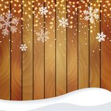 Wooden Christmas background with a snowfall Royalty Free Stock Photography
