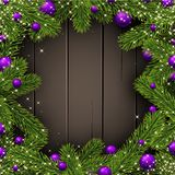 Wooden Christmas background with spruce branches. Stock Image