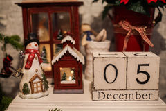 Wooden Christmas calendar in the interior. Wooden calendar on every day Royalty Free Stock Photography