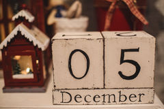 Wooden Christmas calendar in the interior. Wooden calendar on every day Stock Photos