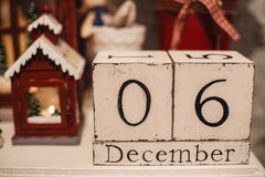 Wooden Christmas calendar in the interior. Wooden calendar on every day Royalty Free Stock Image